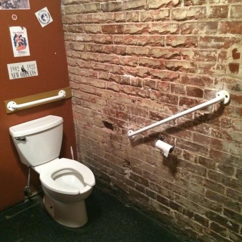 Cajun toilet wall